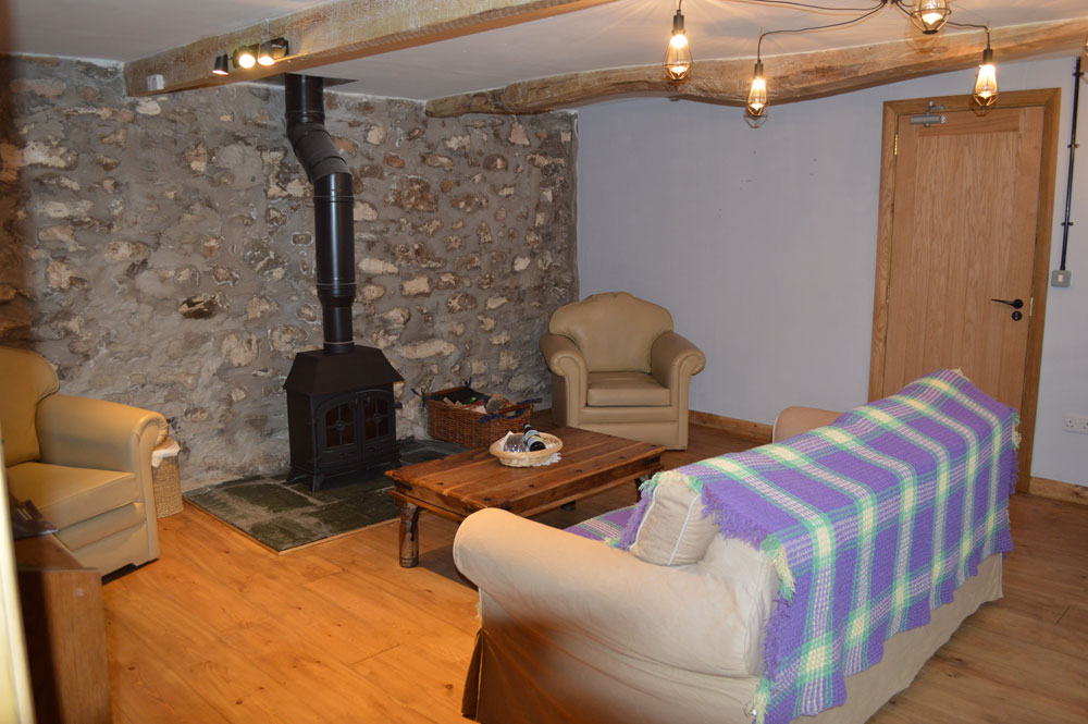bunkbarn with log burner in the lakes